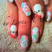 季節を問わないパステルマルチのヒョウ柄とキティちゃんのコラボデザインです☆ #ハンド #キャラクター #パステル #ジェル #お客様 #hyLovesNAIL #ネイルブック
