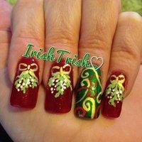 My mistletoe & ribbon nails. :) #クリスマス #ハンド #リボン #レッド #ジェル #セルフネイル #IrishTrish83 #ネイルブック